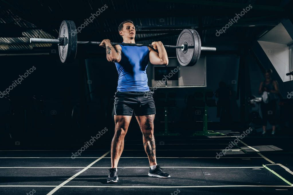 sportsman lifting barbell