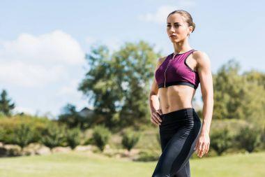 sportive woman posing outdoors