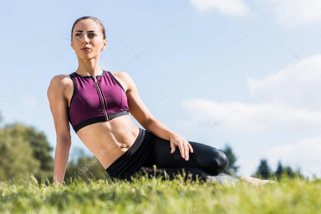 sportswoman laying on grass