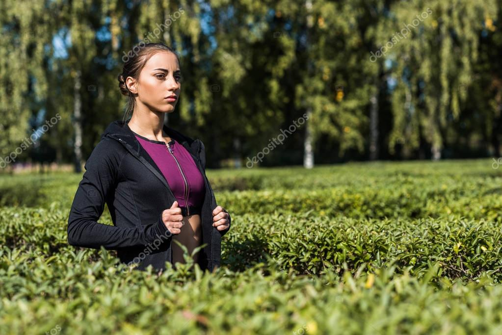 fit woman walking by park