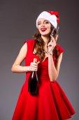 Fényképek lány a Santa kalap pezsgővel