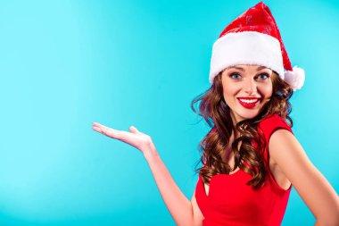 presenting girl in santa hat
