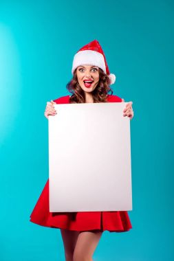 excited santa girl with blank placard