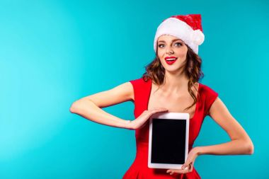 woman in santa costume presenting tablet