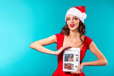 santa girl with tablet and ebay website