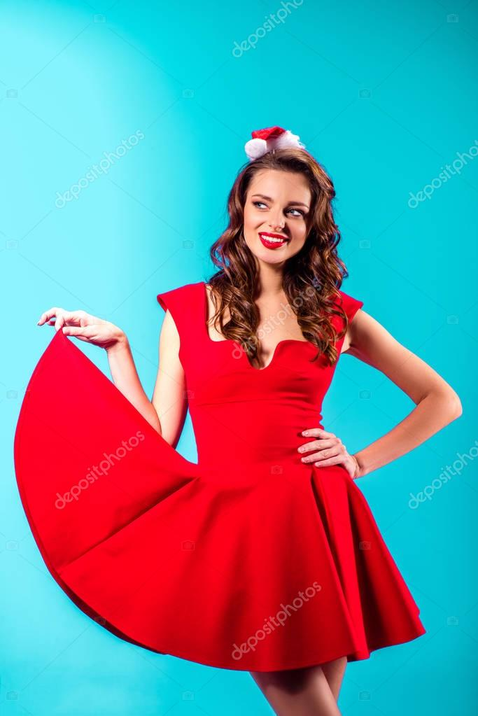 girl in red dress and santa hat