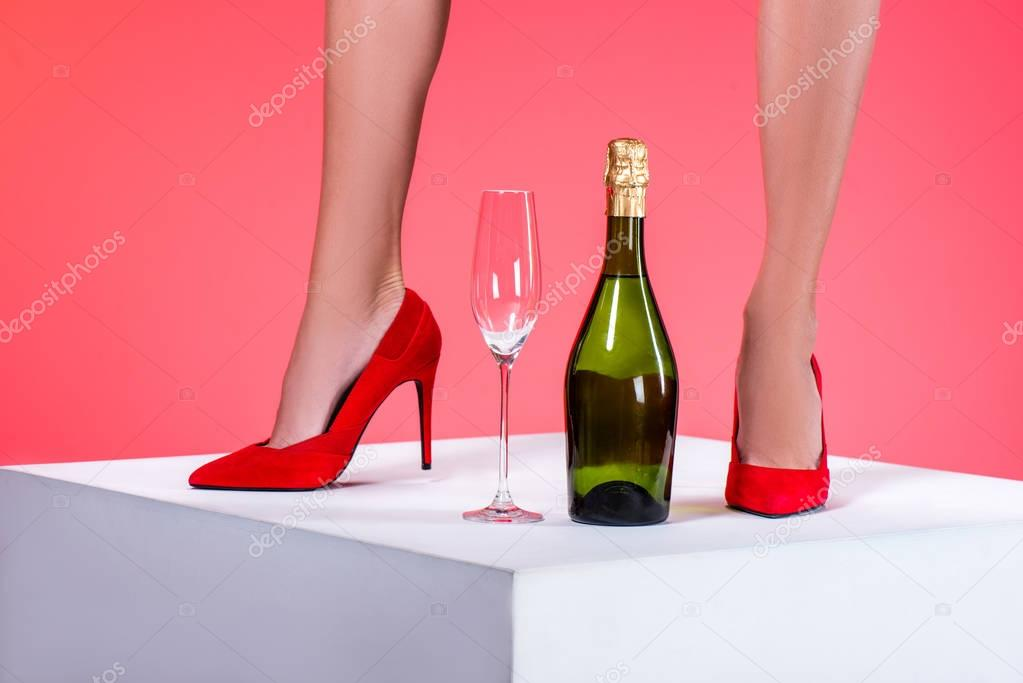 female legs and champagne