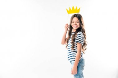Smiling Female kid standing with paper crown on stick isolated on white stock vector