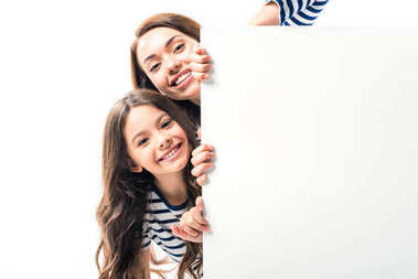 Daughter and mother holding white empty board isolated on white stock vector