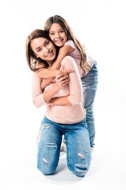 Daughter hugging smiling mother