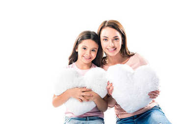 Daughter and mother with heart shaped pillows