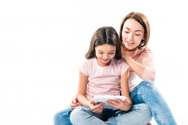 Mother and daughter looking at tablet