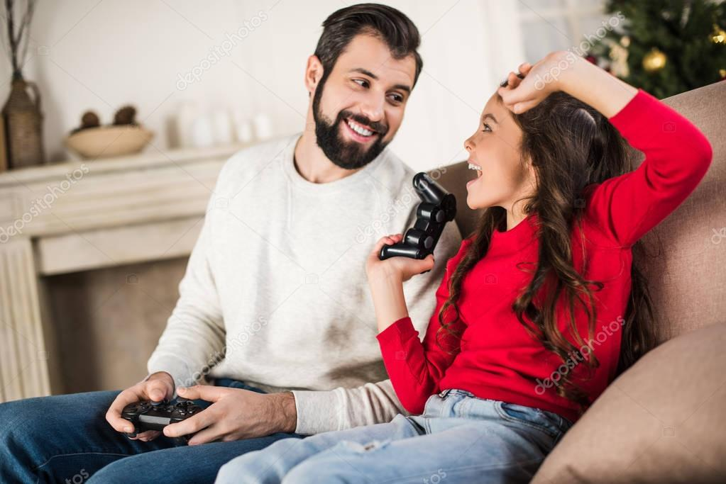 daughter winning father with video game