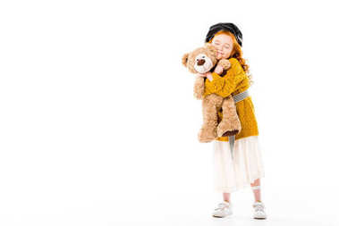 Smiling red hair child hugging teddy bear with closed eyes isolated on white stock vector