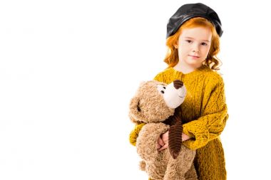 Red hair child holding teddy bear and looking at camera isolated on white stock vector