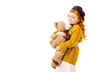 happy red hair kid hugging teddy bear isolated on white