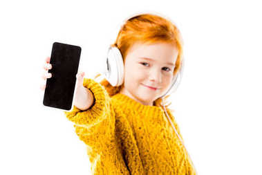 red hair kid showing smartphone isolated on white