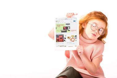 red hair kid sitting and showing loaded ebay page on tablet isolated on white