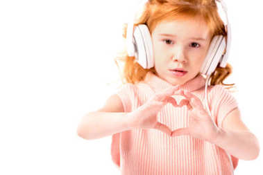 red hair kid in headphones showing heart with fingers isolated on white