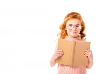 red hair kid standing with open book isolated on white