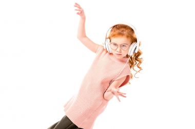 Red hair kid listening music in headphones and dancing isolated on white stock vector