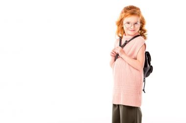 red hair kid with backpack looking at camera isolated on white