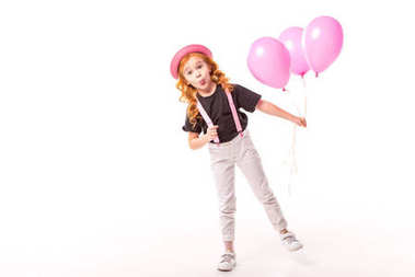 grimacing red hair kid standing with pink balloons on white