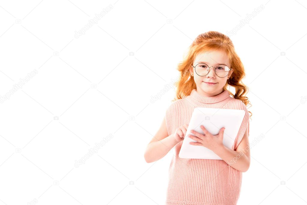 red hair kid holding tablet and looking at camera isolated on white