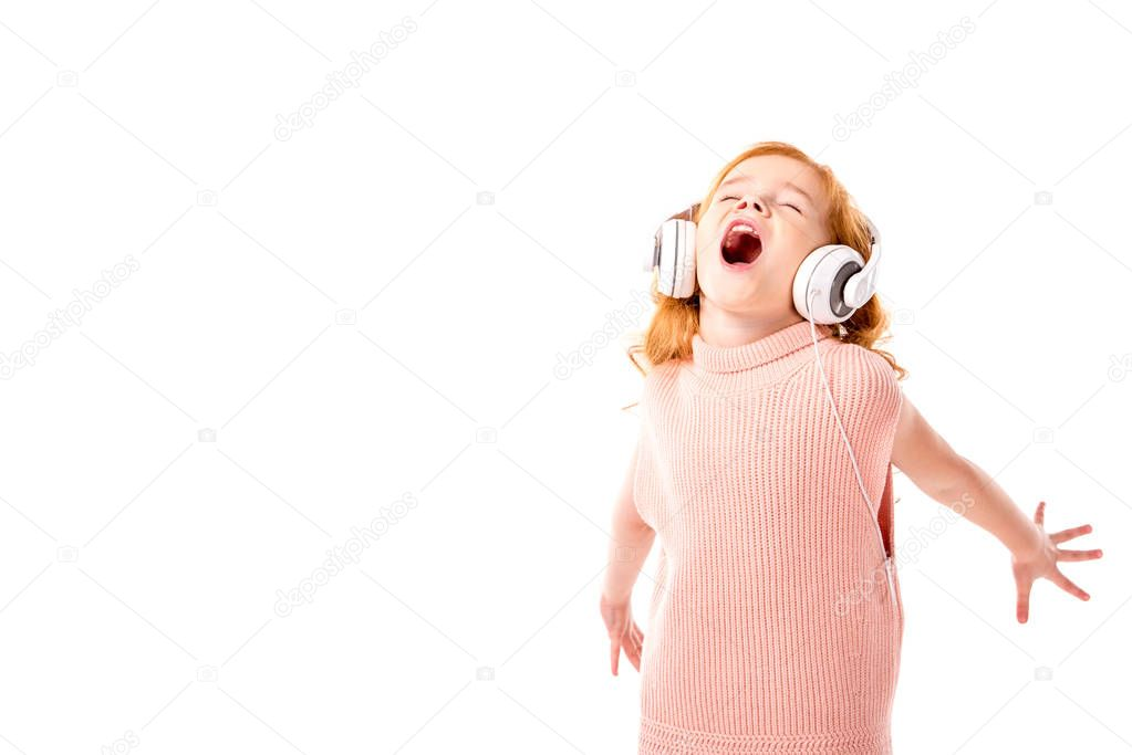 red hair kid in headphones screaming and dancing isolated on white
