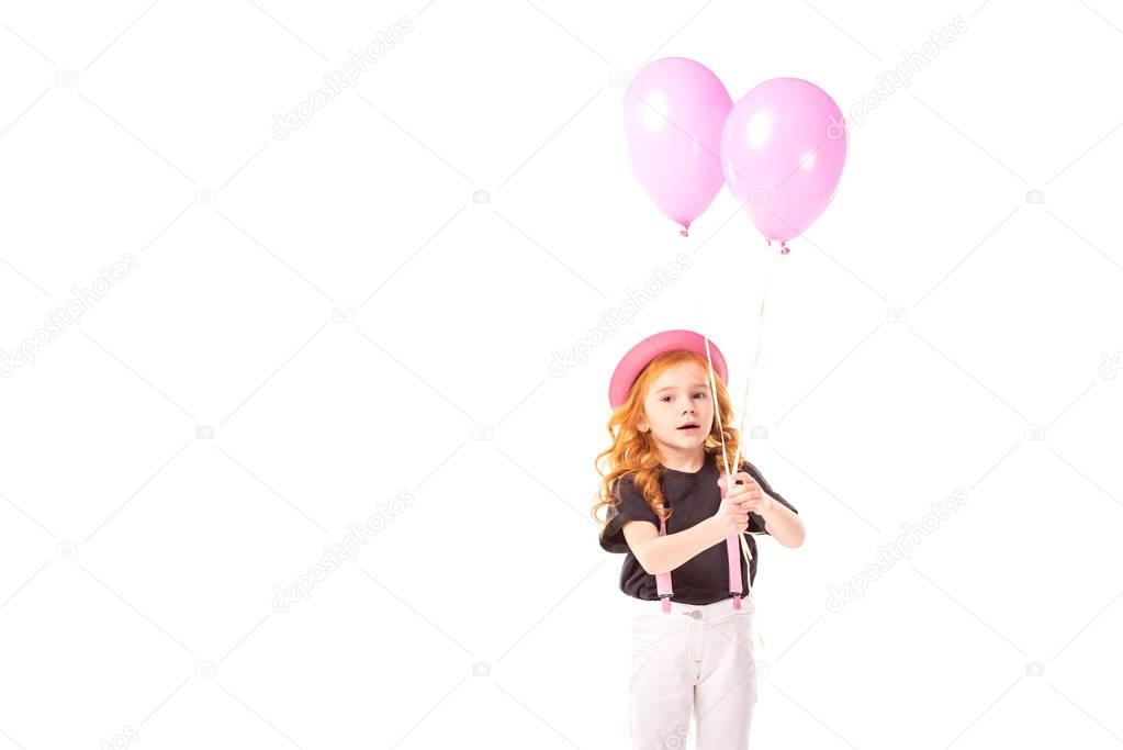 adorable kid standing with pink balloons isolated on white