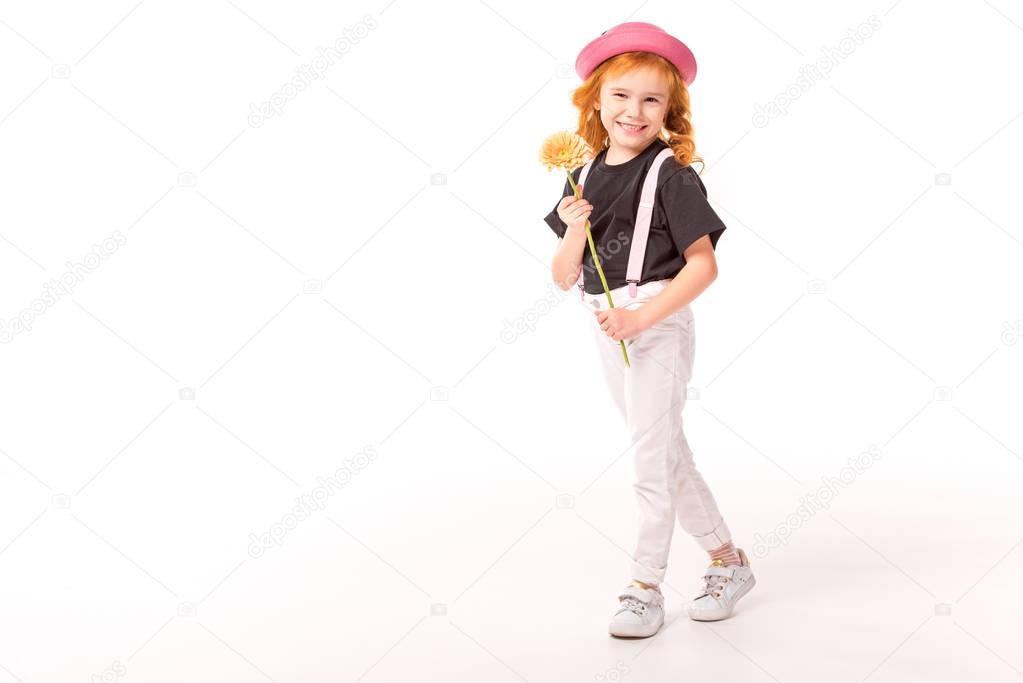 smiling kid holding flower on white