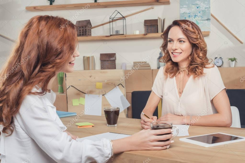attractive young businesswomen working together at modern office