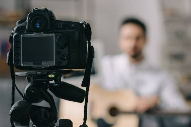 digital camera and music blogger on blurred background