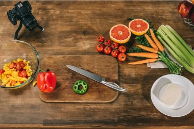 overhead view of vegetables and fruits on wooden table