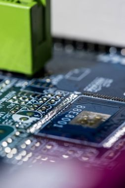 close up view of computer motherboard with chip
