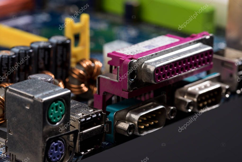 close up view of computer motherboard colorful ports