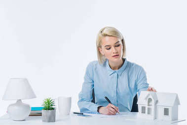 portrait of focused real estate agent working at workplace
