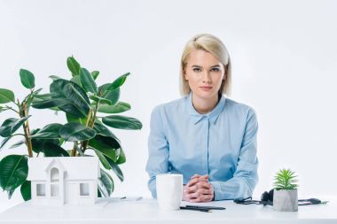 portrait of confident real estate agent sitting at workplace