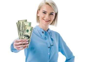 Happy businesswoman holding dollar banknotes, isolated on white stock vector