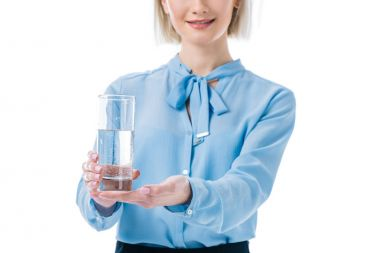Cropped view of businesswoman holding glass of water, isolated on white stock vector