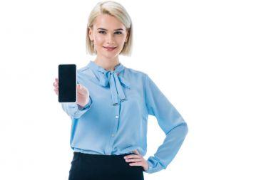 beautiful stylish businesswoman presenting smartphone, isolated on white