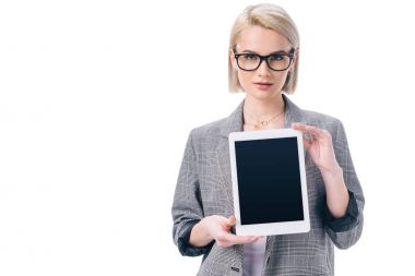 attractive stylish businesswoman in formal wear presenting digital tablet, isolated on white