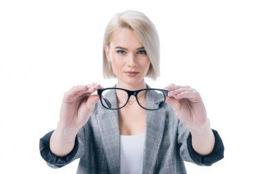 Beautiful blonde woman holding eyeglasses, isolated on white stock vector