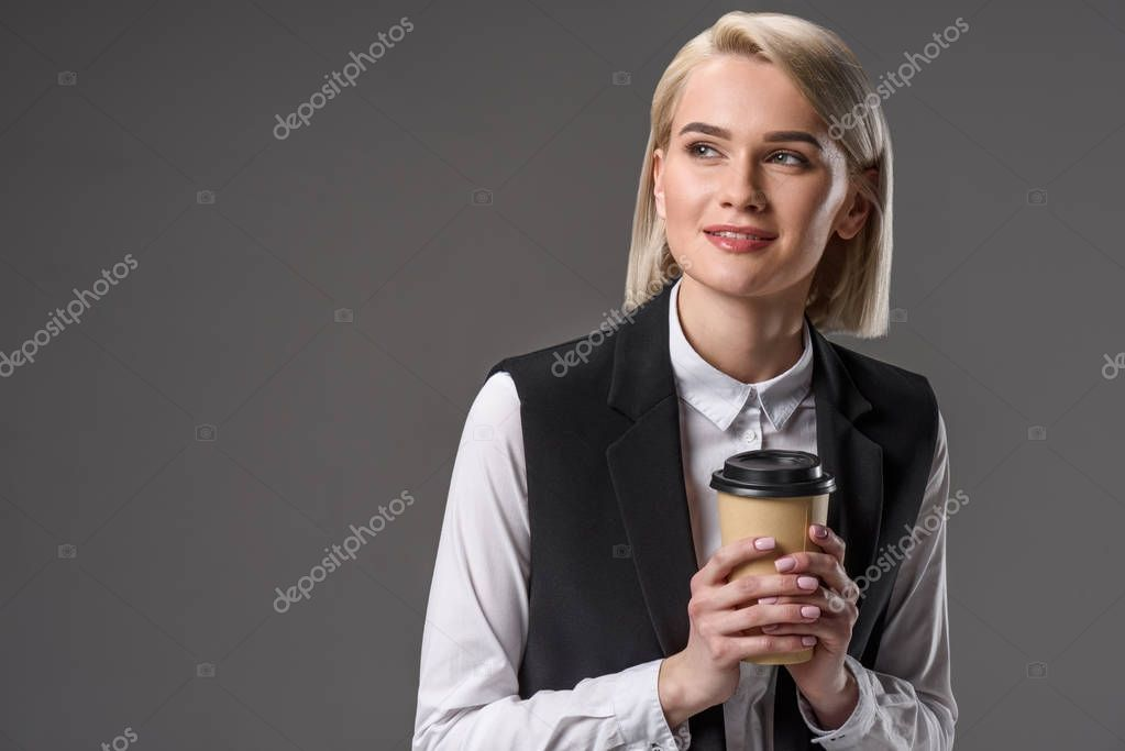 portrait of beautiful stylish woman with coffee to go isolated on grey