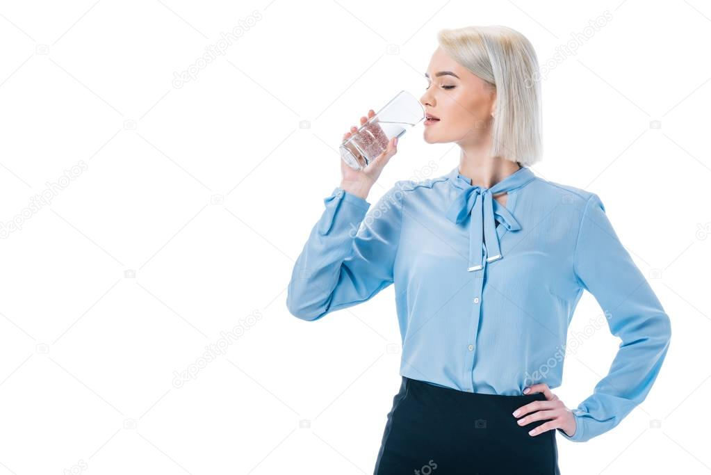 beautiful elegant businesswoman drinking water, isolated on white