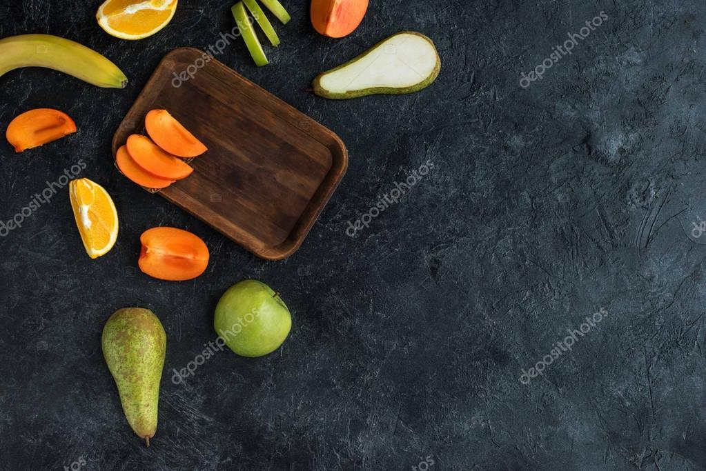 flat lay with ingredients for healthy breakfast on dark tabletop