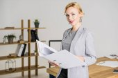 Fotografie portrait of attractive businesswoman with folder in office