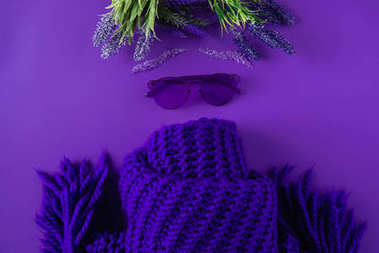 top view of glasses, scarf and flowers isolated on purple