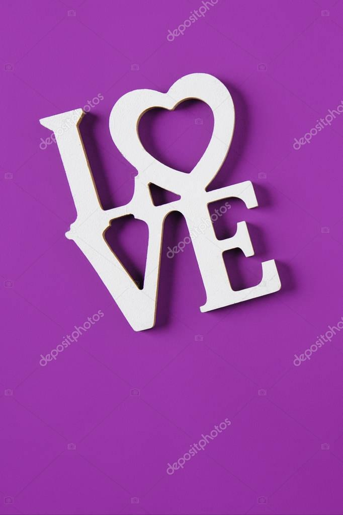 Top view of word love isolated on purple, valentines day concept stock vector