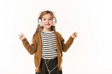 Smiling little child listening music with headphones isolated on white stock vector